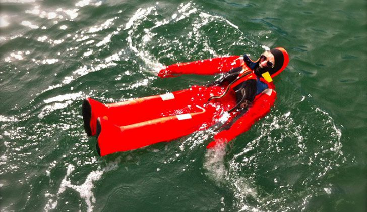 AMSEA's executive director Jerry Dzugan floats in an immersion suit as part of a training exercise. AMSEA photo.