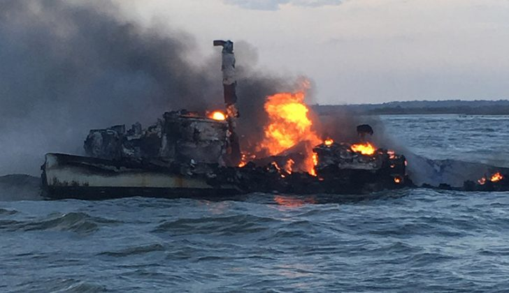 The Coast Guard rescued three fishermen Feb. 7, 2017, after their vessel caught fire 1 mile east of St. Catherines Island, Ga. USCG photo.