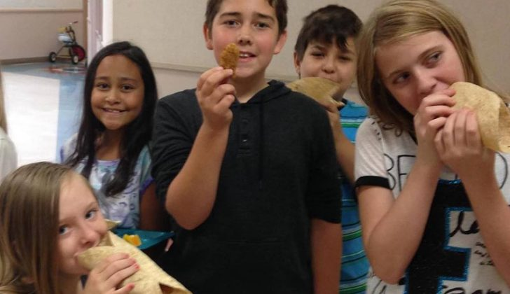 Students enjoying fish sticks made with Alaska Pollock. Photo courtesy Alaska Pollock - Great Fish for Great Kids Facebook page.