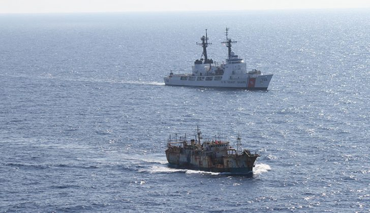 The crew of the Coast Guard Cutter Rush escorts the suspected high seas drift net fishing vessel Da Cheng in the North Pacific Ocean Aug. 14, 2012. USCG photo.