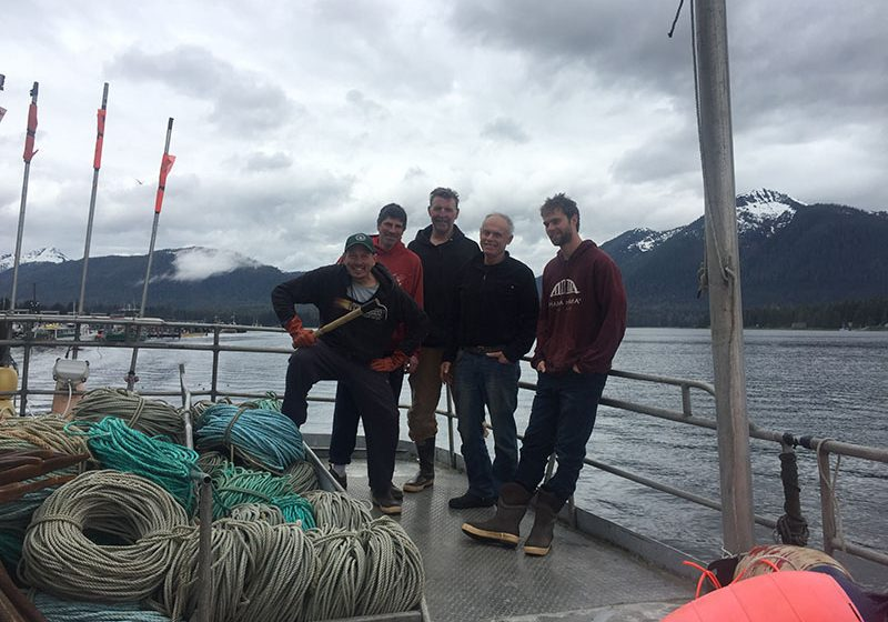 The crew of the F/V Discovery (L-R: Capt. JD, Matt Marinchovich,Big George, Mike Carr, and son Rich Carr) making their final halibut delivery in Petersburg, Alaska, in May before heading home to Port Townsend, Wash.