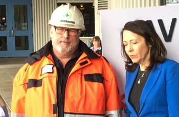 Doug Dixon, general manager of Seattle's Pacific Fishermen Shipyard, stands with Sen. Maria Cantwell at a Seattle rally to oppose the proposed Pebble Mine in Alaska. Jerry Fraser photo.