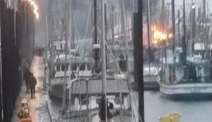 Firefighters respond to three commercial fishing vessels ablaze in Craig, Alaska's North Cove Marina on May 21, 2017. Scott Willburn photo.