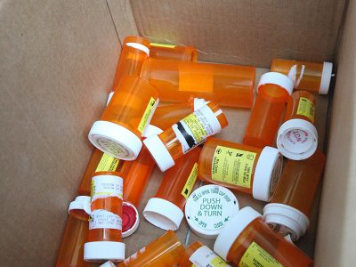 Prescription pill bottles collected as part of a drug take-back event. U.S. Marine Corps photo.