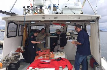 A U.S. Coast Guard commercial fishing vessel dockside safety exam in progress. Jessica Hathaway photo.