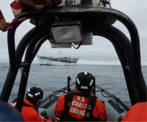 A boarding team aboard an over-the-horizon cutter boat from Coast Guard cutter Mellon approaches a fishing vessel to conduct an at-sea boarding in the North Pacific Ocean, Aug. 13, 2019.