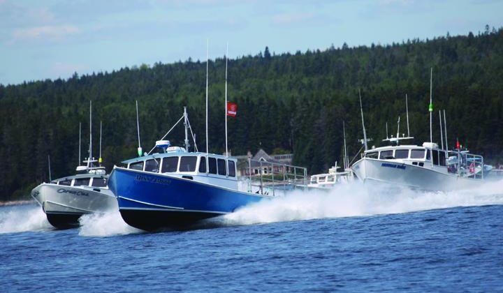 The Winter Harbor 2018 lobster boat races. The event this weekend features a brand new Mitchell Cove 35 bare hull in a prize drawing. Jon Johansen photo.