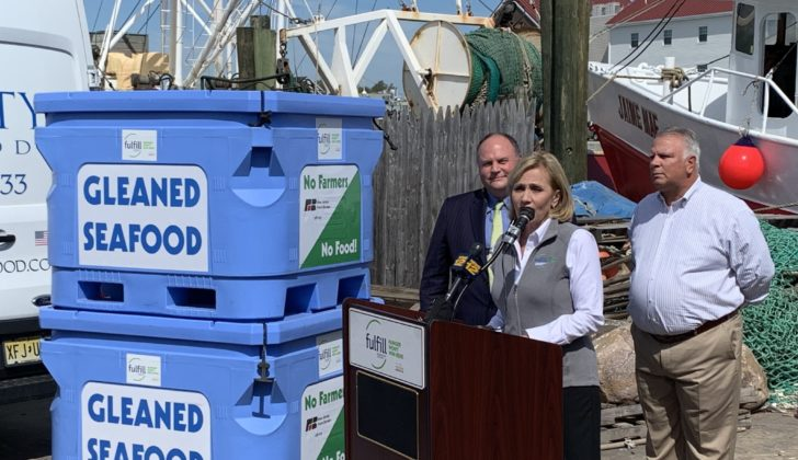 Kim Guadagno, CEO of the Fulfill food bank, talks about her group's effort with America's Gleaned Seafood as fisherman Brick Wenzel, left, and PointPleasant Beach, N.J. Mayor Stephen Reid listen. Kirk Moore photo