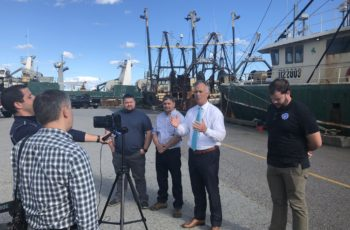 New Bedford Mayor Jon Mitchell appeared with Charlie and Michael Quinn of Quin Fisheries, to announce they had close on six of Carlos Rafael's former scallop vessels for around $40 million. New Bedford mayor's office photo