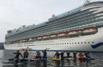 Paddlers protest near a cruise ship in Monterey Bay, Calif. Brent Allen photo.