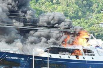 The tuna seiner Jeanette burns in Pago Pago Harbor, American Samoa, on Dec. 5, 2018. Coast Guard photo.