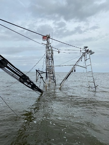 The 62-foot Peruga remains submerged in Lake Borgne. George Barisich photo.